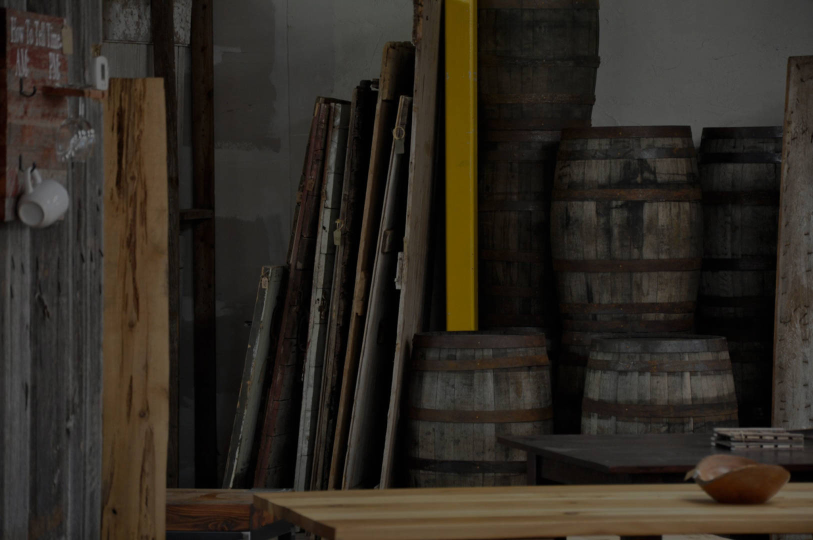 Backroom stocked with rustic barn wood for DIY reclaimed wood projects.