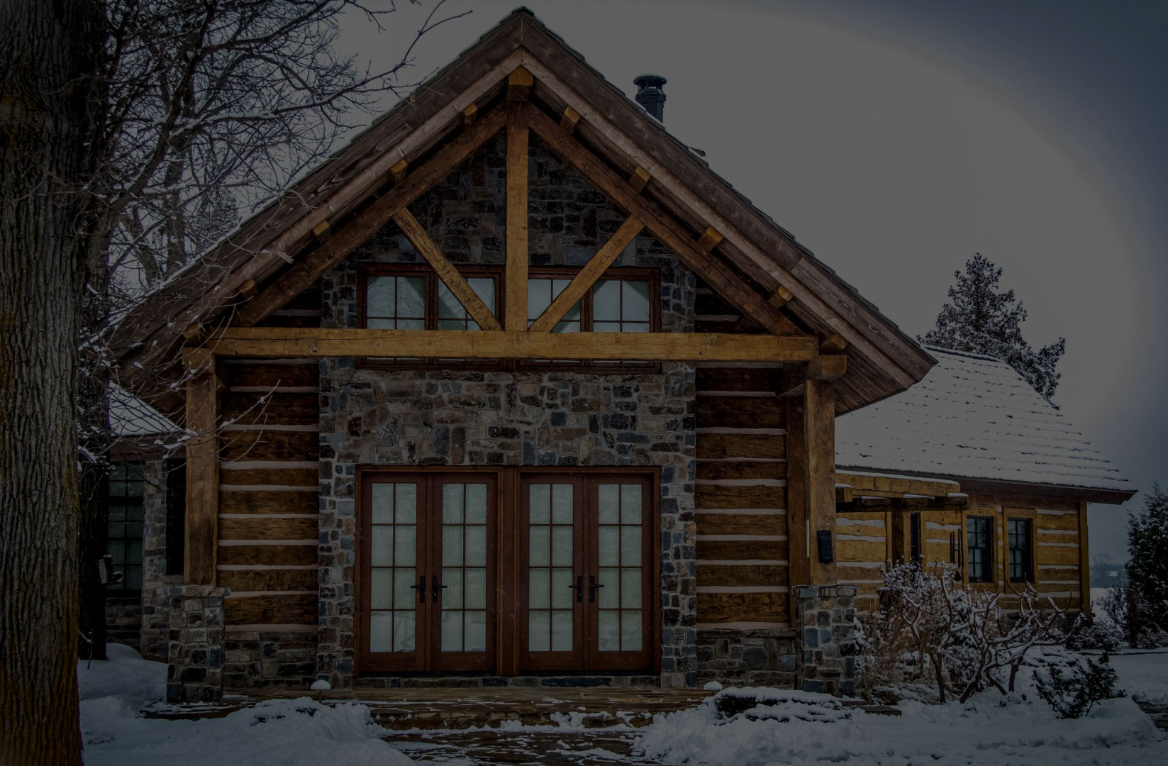 Cabin exterior featuring vintage reclaimed lumber construction.