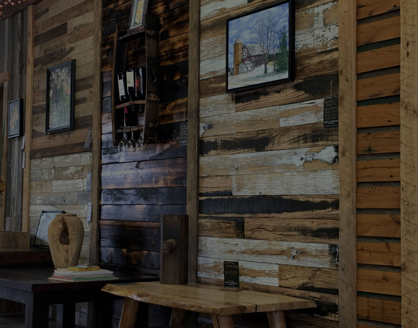 Our showroom, featuring a selection of reclaimed wood furniture and reclaimed wood beams.